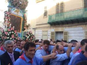 The men carrying the Madonna during a 6 hour procession through the town.